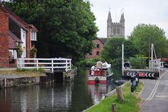 Newbury, Berkshire A narrowboat passes the swing bridge at Newbury, Berkshire. A picture of: Berkshire, Newbury
