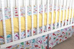 bumperless crib bedding with an all-in-one sheet that functions like a bumper with coordinating fabric on the side of sheet and edged with piping. Fabric name: 'flock' available from MissPollysPieceGoods https://www.etsy.com/listing/191705405/custom-modern-baby-crib-bedding-design? #cribbedding #birds #yellow #dots #bumperless #nursery #misspolly #custommade