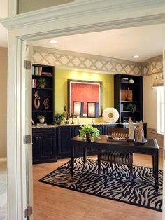 The zebra print rug and built in bookcases really make this home office pop! It looks so professional, yet still cozy!   Birchwood at Easton Park | Mobley Homes