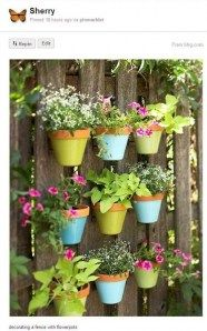 Fence decoration with flower pots