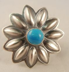 Sterling silver and #turquoise flower pendant by #Navajo silversmith Robert Johnson
