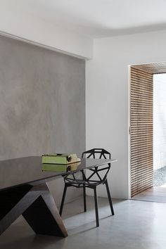 not bad combination this bold table and thin easy chair.. also how the grey wall tunes to floor