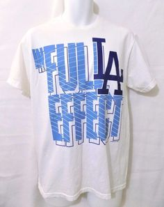 """#MLB #GraphicTee 100% #cotton solid white #MLB #baseball genuine merchandise Los Angeles/LA #Dodgers """"The Full Effect"""" short sleeve style basic t-shirt #shirt with two (2) tone blue screen/graphic print logo and matching white stitching/threading in #mens size medium/M, excellent used condition https://www.ebay.com/itm/EUC-MLB-LA-DODGERS-THE-FULL-EFFECT-SHORT-SLEEVE-T-SHIRT-SHIRT-MENS-SIZE-MEDIUM-M-/142591472730?hash=item21331d345a"""