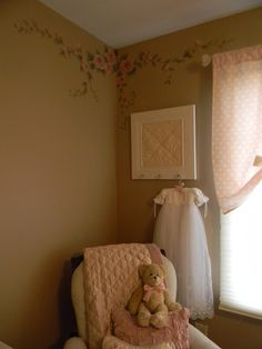 What a great idea to hang the christening gown!