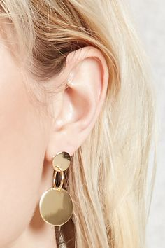 A pair of high-polish drop earrings featuring circle designs and post backs.