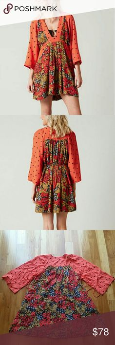 """FREE PEOPLE V NECK TULULLA PRINTED BOHO CHIC DRESS SEAM CAME UNDONE ON THE V NECK BUT WAS FIXED.SEE PICTURES 4.5  GOOD CONDITION. 100% RAYON. COLOR CHERRY COMBO.SZ XS.MINI DRESS.SWINGY MINI DRESS STYLE . PLUNGING NECKLINE. PLEATED SKIRT.DRAWSTRING WAIST FIR AN EASY,EFFORTLESS FIT.WIDE,RELAXED SLEEVES. LENGTH APPROX 30"""",ARMPIT TO ARMPIT APPROX 18.5"""" ALL MEASUREMENTS ARE TAKING WITH THE GARMENT LYING FLAT. ПР18 Free People Dresses Mini"""