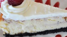Raspberry sauce is swirled into the batter of a creamy white chocolate cheesecake. Garnish with white chocolate curls if desired.