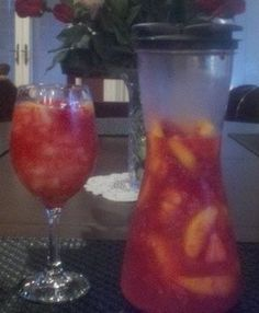 ~My PeachBerry Sangria~ 1 bottle (750 ml) Riesling * ¾ Cup Peach Vodka or Peach Schnapps * ¼ Cup Sugar * 6 Tbsp Frozen Lemonade Concentrate * (Fresh or Frozen) Peaches, Strawberries and Raspberries * Chill for at least 2 hours * Add Sprite or Diet Sprite to dilute/add sparkle. Delicious both ways. Serve over crushed ice.