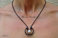 The Uni Necklace is for Women or Men. Shown in the photos above it is worn as a Womans Necklace with a White Freshwater Pearl or a Peacock Freshwater Pearl accented with a Hardened Steel Piece. This Leather Necklace is made 20 inches fitting either male or female wearers, but you may request a custom size in comments when ordering. The clasp is a magnetic stainless steel with a safety turn latch. Pearl and Leather Jewelry definitely can be worn by Men as well as Women. This Unisex necklace…
