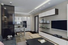 Nappali és konyha kialakítása egy térben - gyakran alkalmazott megoldás a tágasság érzetének növelésére kisebb alapterületű lakásokban. Ebben az 50 négyzetméteres lakásban erre láthatunk példát, a tervezők itt viszont gondoskodtak a konyha leválaszthatóságáról, a két zónát eltolható sötét üveg válaszfal különítheti el ha erre van szükség - pl. főzés közben.