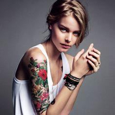 flower sleeve I think tattoos on women can be very tasteful and pretty