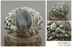 This men's moonstone ring is handmade to harness the beauty of this stone. Made under a partnership with National Geographic, the ring is engraved with a lion design, while the rainbow stone appears different colors in different light.