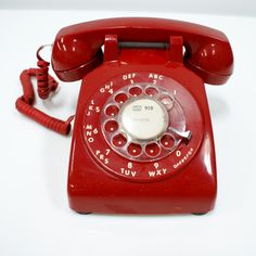 Vintage red rotary phone. This would look very cool with modern furniture.