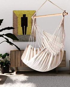 Having a great hammock or a swing in your backyard is cool, but putting one up inside your home? Now that's a refreshing way to give a new meaning to hanging out. There's something extra cozy (not to mention totally chic) about indoor hammocks and hanging chairs—it's like you can just curl up and float on cloud nine right there in your living room. No matter what your style is, from rainbows to macramé, there's a hanging retreat for everyone on this list. Indoor Swing, Indoor Hammock, Hammock Chair, Hammocks, Hanging Out, Hanging Chairs, Cozy Family Rooms, What's Your Style, Beautiful Homes