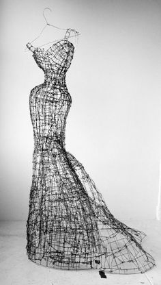 "Wire sculpture: ""Madeline."" Wouldn't this look fabulous in a garden, with a clematis vine twisting through it? Materials: industrial wire fencing, rebar tie-wire."