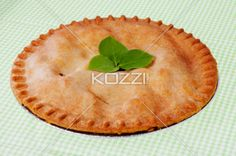 apple pie ready to eat. - Apple pie garnished with leaves ready to eat.