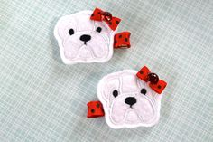 Cute pair of red and black felt clips reminiscent of the University of Georgia bulldog. White felt bulldog with white stitching and a red and black polka dot bow.  Go dawgs!  Go UGA!
