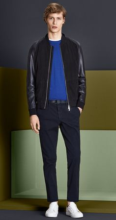 Dark blue leather jacket, knitwear, white jersey, dark blue trousers with a black belt and white shoes by BOSS