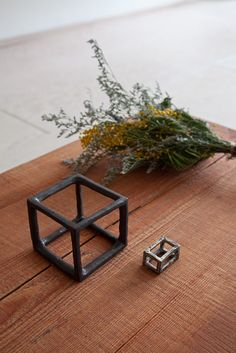 """Love this little box of air by Ando Wasanobu. """"The special art piece made for  an exhibition at Mjölk is """"a box of air"""". Inspired by the volume within the Japanese bedroom, it allows the user to recreate this sacred space by placing a small stone or flower in the middle of the square."""""""