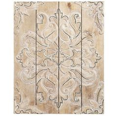 Damask isn't just for textiles anymore. Rich in history, this traditional pattern offers sophistication pretty much anywhere it goes—including your wall. Indonesian artisans hand-carve an oversized damask design on our albasia wood wall panel and embellish it with mirrored tiles for a gorgeous, shimmering effect.