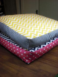 DIY giant chevron floor pillows. If I were super crafty, I'd make them. Since I'm not I shall have to find someone local to do it for me :)