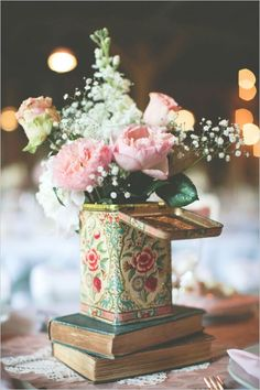 Old books and vintage tins make for wonderful centerpiece bases and vases.