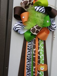 I don't know what it is about giraffe print but I just can't get enough. safari party- baby shower corsage-safari baby shower