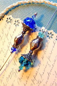 One Fish, Two Fish, Aqua Fish, Blue Fish Victorian style hat pins or scarf pins. Gaffney Girl Studio