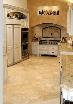 Travertine floors with white cabs and granite color looks like where I'm headed