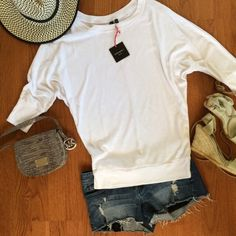 ⓒⓨⓝⓣⓗⓘⓐ ⓡⓞⓦⓛⓔⓨDolman Top New. Dolman 3/4 sleeve, white, top. Has a tiny imperfection on back at neckline, shown in images above. Jean shorts, displayed in picture, are also for sale.  Cynthia Rowley Tops Tees - Long Sleeve