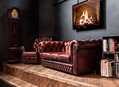 brown leather tufted couch against dark walls. Tufted Couch, Chesterfield Chair, Dark Interiors, Wood Interiors, Masculine Interior, Brown Interior, Lobby Design, Cool Office, Office Ideas
