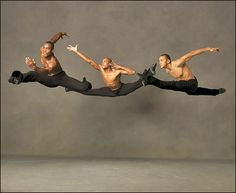 "Alvin Ailey American Dance Theater's Jamar Roberts, Antonio Douthit and Clifton Brown in Alvin Ailey's ""Revelations"""