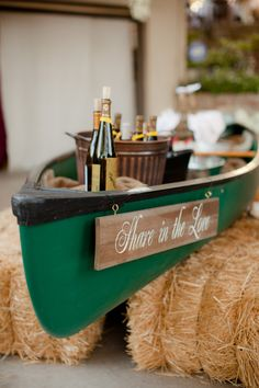 """Great way to tie in a pop of color and some fun! """"Share in the Love"""" wooden sign hanging off a canoe filled with wine. @style me pretty"""