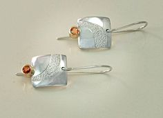 Earrings: Textured tarnish resistant sterling silver with sapphires set in 9ct gold.