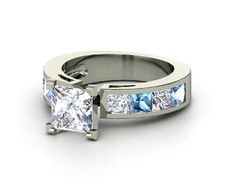 Princess cut diamond in platinum. Wide band with a few blue topaz and diamond accent stones. AHH <3