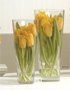 Submerge your Flowers for Chic and Cheap Centerpieces in just a little bit of water on bottom of vases