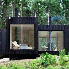 """Nestled into the idyllic forested landscape, this retreat seems to grow right out of the ground with its charred wood facade. The interiors, in stark…"""
