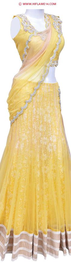 Rent : Charming Yellow Lehenga Saree  An amazing charming design that is accentuated with beautiful white stones that are placed on the hem of the pallu. The lehenga skirt is double layered with a net outer layer and a floral pattern inner layer that is enhanced with hanging tassels on the side. The ready to wear blouse is decked with white stones, the bust size is 36 inches with blouse length 14 inches, and the attachable sleeve length is 5 inches.
