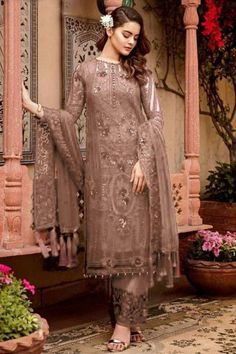 Get gorgeous in this dark beige georgette trouser suit which will make your look very subtle yet edgy. This round neck and full sleeve suit elaborated using sequins and thread work. Accompanied by a matching santoon straight pants in dark beige color with dark beige nazneen dupatta. Straight pants has sequins and thread work. #trousersuit #salwarkameez #malaysia #Indianwear #Indiandresses #andaazfashion Eid Outfits Pakistani, Pakistani Suits Online, Eid Dresses, Indian Dresses, Lehenga Choli, Salwar Kameez, Trouser Suits, Trousers, Georgette Fabric