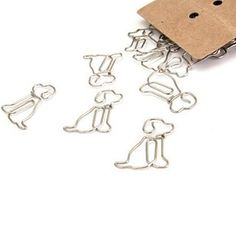 A set of paperclips shaped like cute puppies. | 19 Adorable Things That Will Actually Organize Your Desk