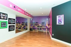 Cute In Home #Dance #Studio with mirrors, photos, and trophy space.