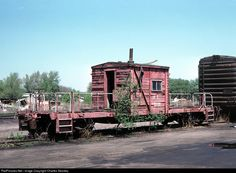 ENID OK April 28 1980 -- This sad caboose hadn't been used in awhile as evidenced by the tree growing out from underneath. Sadly, it was a symptom of things to come. The slide mount says Enid but I could be wrong. It could be Harter Yard in OKC. Any input?