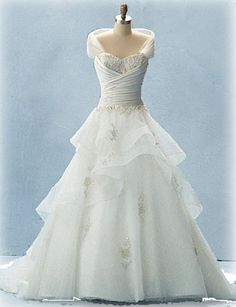 This is a dress design mixed from 3 Disney princess wedding dresses designed by Alfred DiAngelo