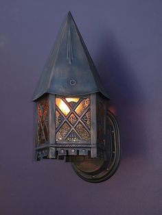 storybook or Tudor style porch light, with yellow pebble glass inserts