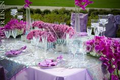 Orchid purple and silver wedding tabletop. Large sequin overlay