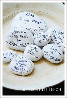 Write inspiring statements on rocks. Themes: religion, graduate, birthday, love. anniversary, etc. A bowl of these --