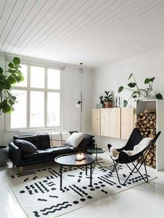 The black sofa works well with the minimalist room. Would do a grey carpet instead.