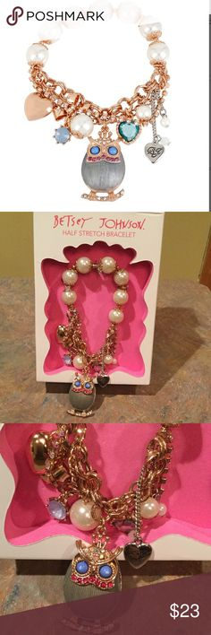 NWT Betsey Johnson owl half stretch bracelet New in the box Betsey Johnson gold owl half stretch bracelet, half faux pearl beads stretch with gold chain link lower half with bow, hearts, large owl and miscellaneous charms dangling; some wear of the blue paint on center of owls eyes however wouldn't be noticeable when wearing (it was like this when purchased). Betsey Johnson Jewelry Bracelets