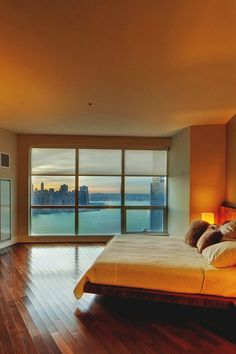 Minimalist bedroom with a view of Manhattan.