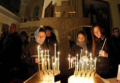 Lithuanian Orthodox light candles on the Eve of the Nativity